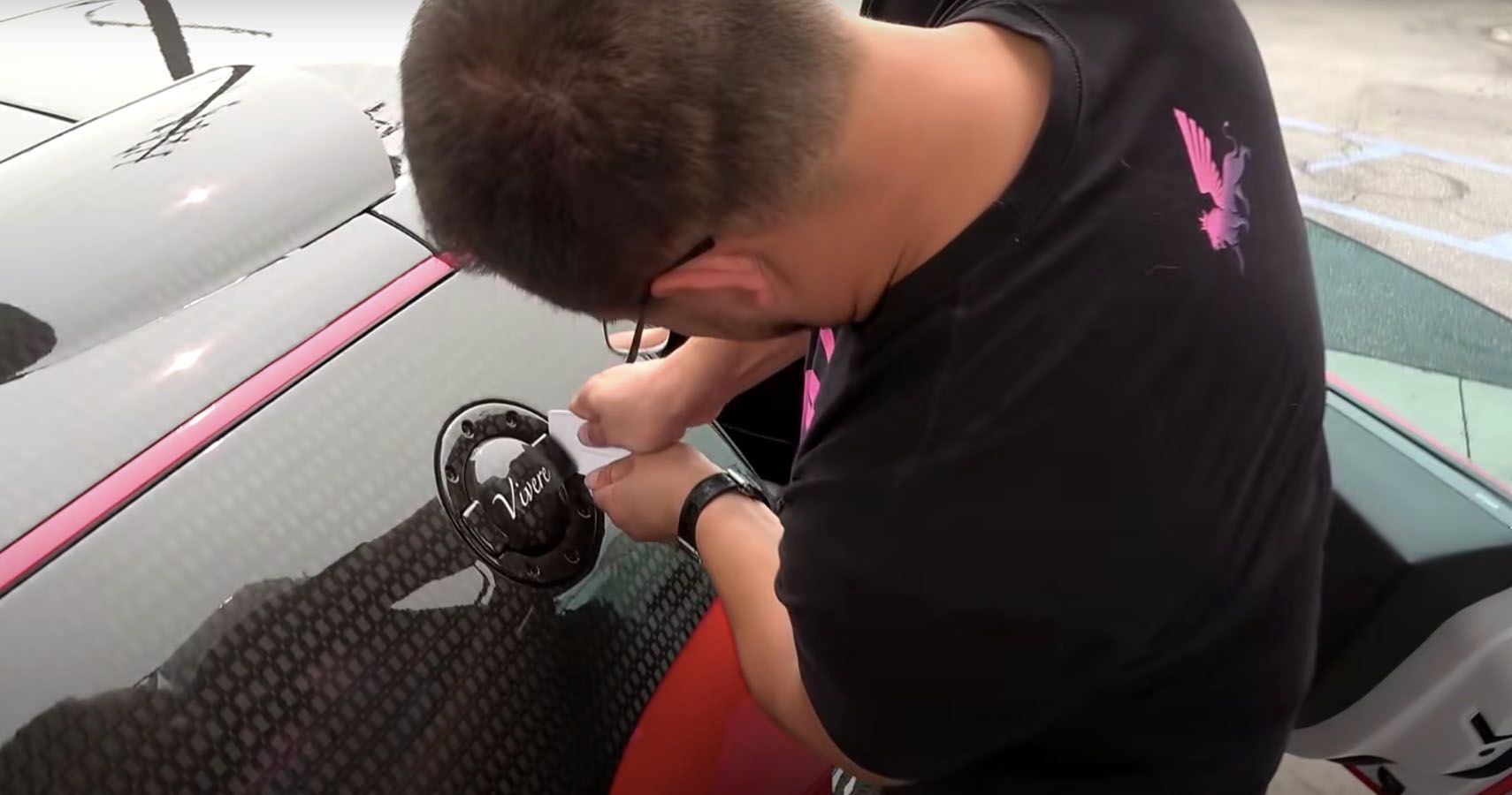 Watch This Mansory Bugatti Veyron Owner Struggle To Get His Gas Cap Open