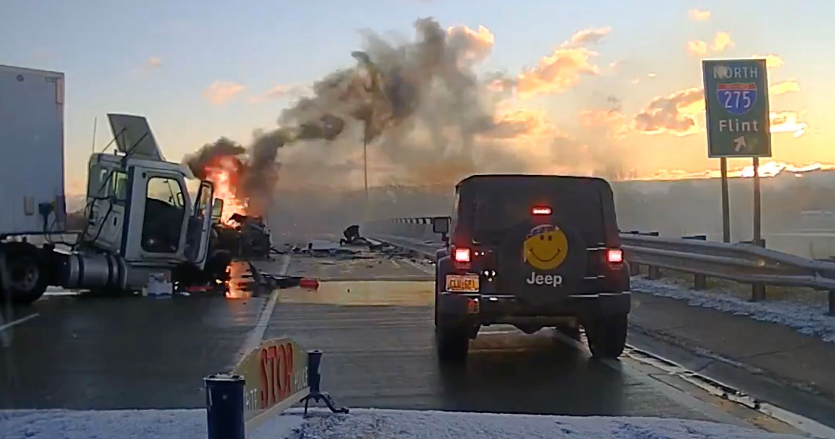 Watch A Michigan State Police Trooper Rescue Man After Fiery Semi-Truck Accident