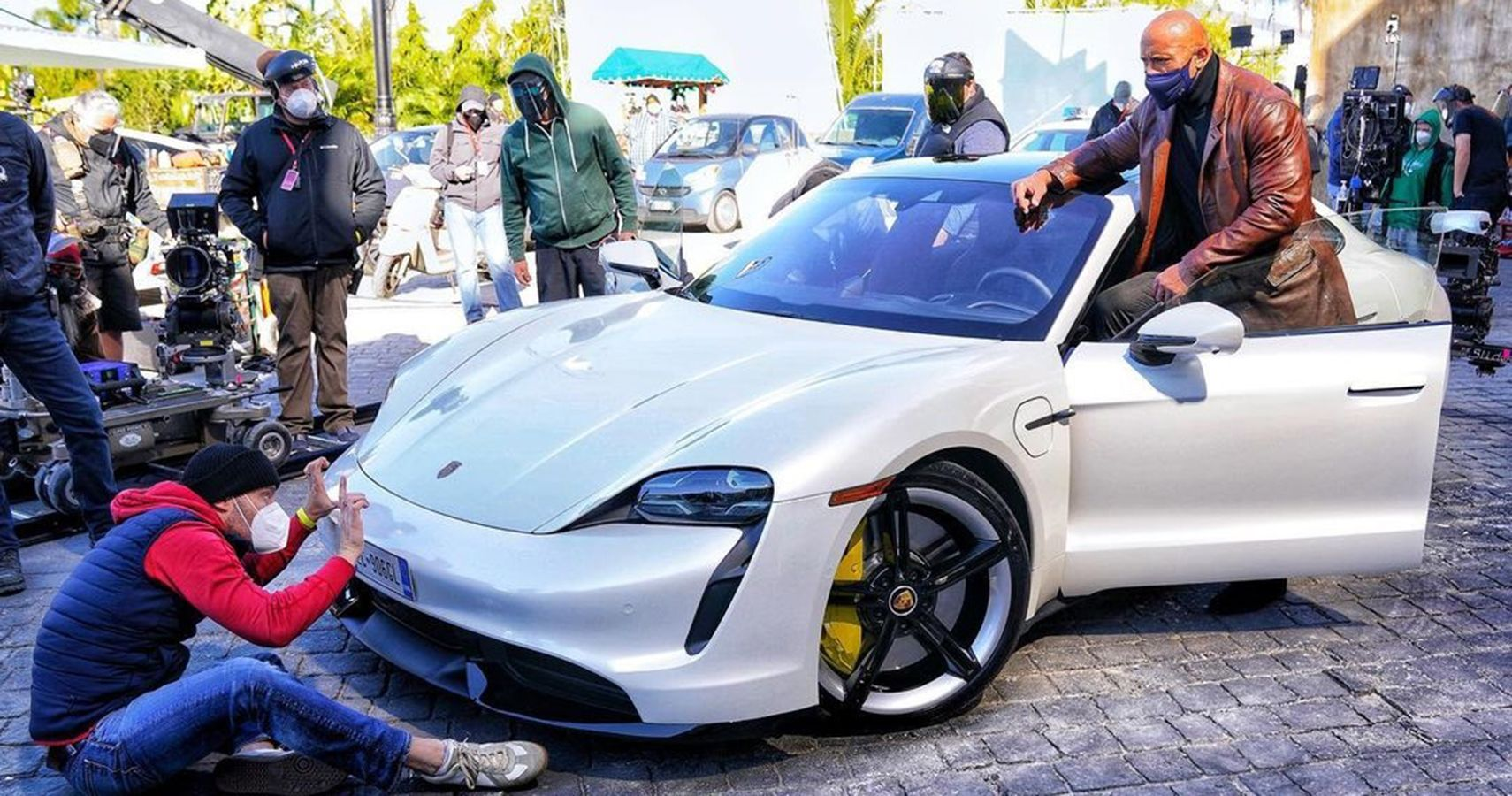 Netflix Production Crew Erupts In Laughter After The Rock Fails To Fit Into Taycan Turbo S